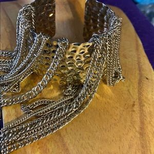 Long gold tone chain with cuff bracelet
